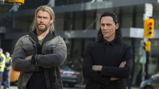 Thor and Loki standing side by side in Thor: Ragnarok