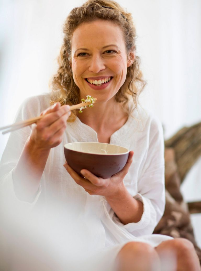 Woman Eating Meal Image