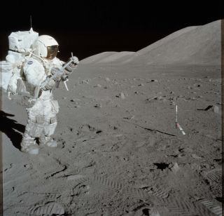Apollo 17 astronaut Harrison Schmitt collects samples during an excursion made on Dec. 11, 1972.