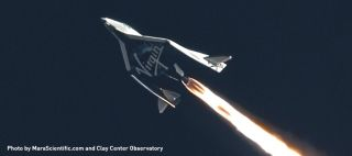 Virgin Galactic's private SpaceShipTwo suborbital space plane streaks across the sky in a supersonic rocket-powered test flight on Jan. 10, 2014 over Mojave, Calif.