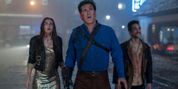 Ash Vs. Evil Dead Ash and his partners staring down an off camera evil