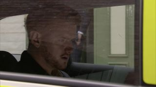 Coronation Street Gary Windass in a poilice car