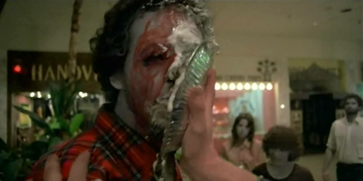 A zombie getting hit in the face with a pie in Dawn of the Dead