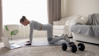 Low-impact cardio workout ideas - A woman does resistance training at her laptop