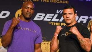 Evander Holyfield and Vitor Belfort pose during a press conference ahead of heavyweight fight