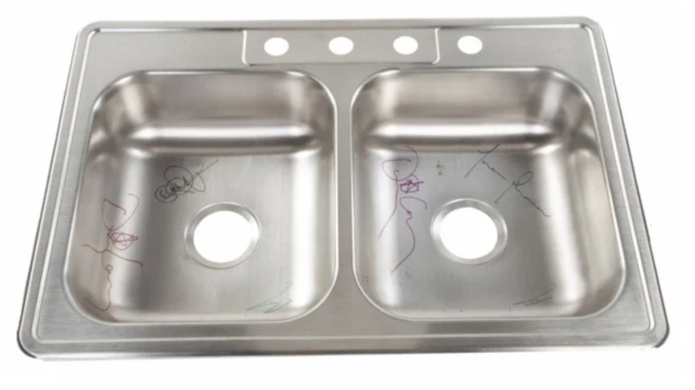 A Sink Autographed By Tool Is Being Auction For Ronnie James Dio S Charity Louder