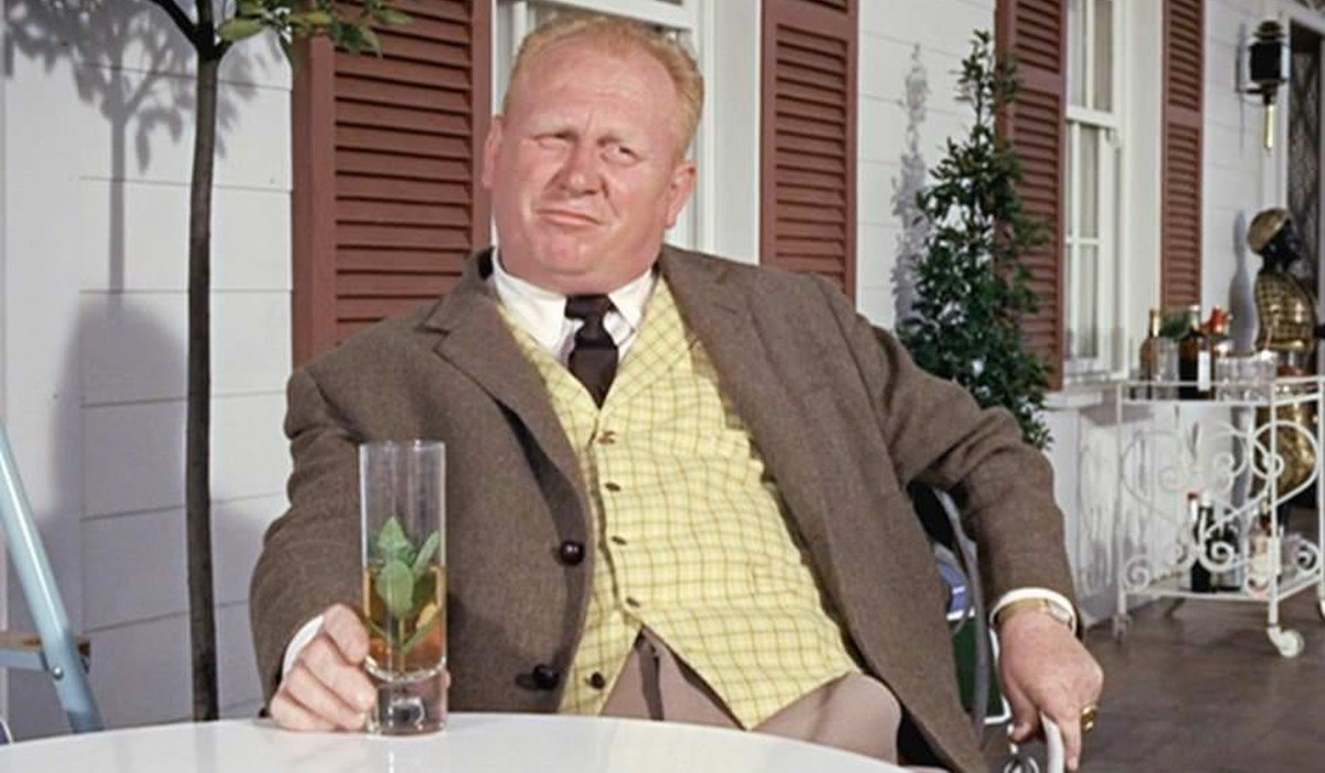Goldfinger Auric Goldfinger has a drink at his table