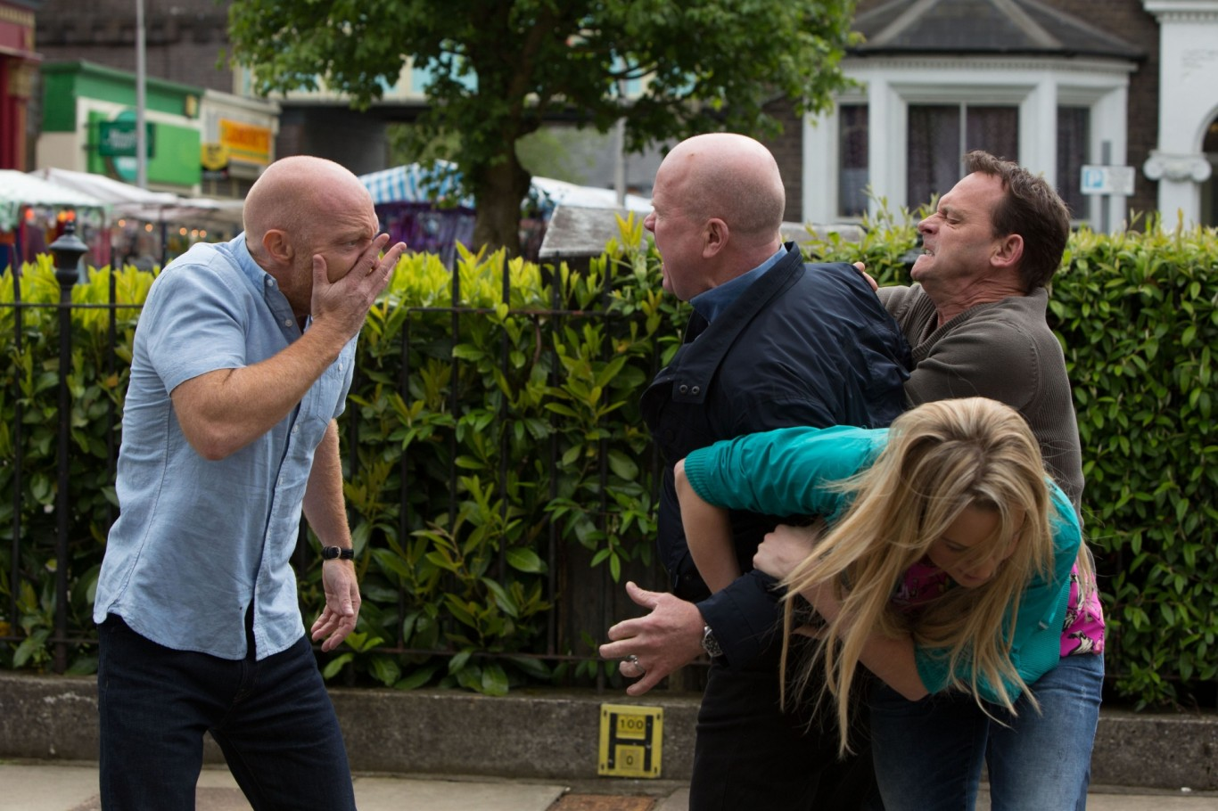 Max Branning gets a punch in the face from Phil Mitchell in EastEnders