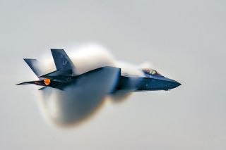 "Air Force Capt. Andrew ""Dojo"" Olson performs a high-speed pass during the Canadian International Air Show in Toronto on Sept. 1, 2018."