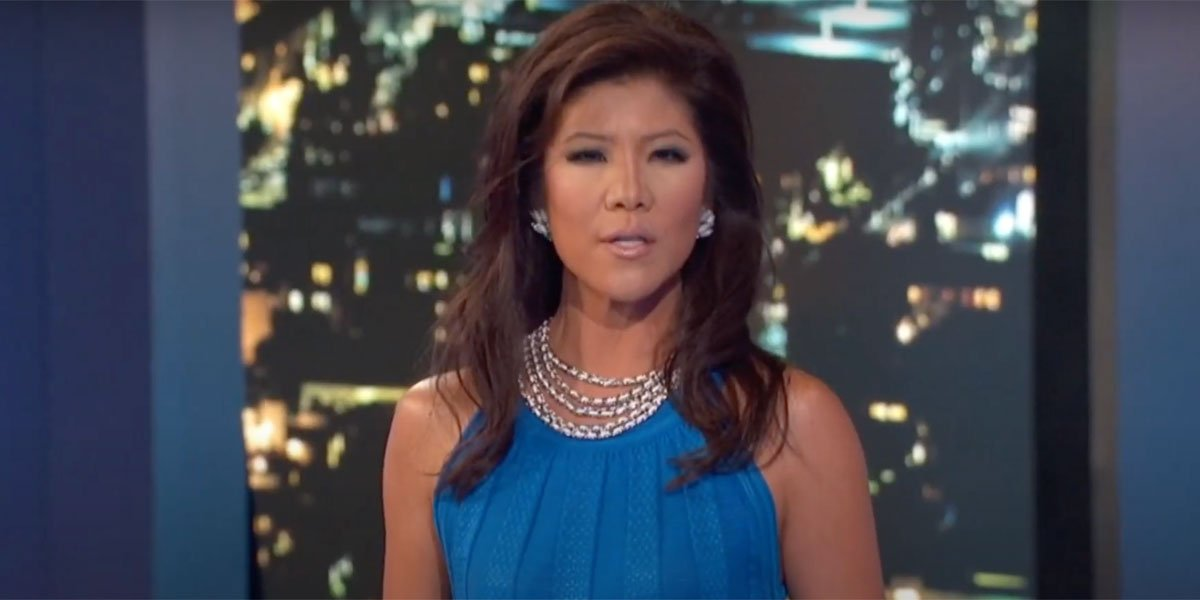 Julie Chen in a blue dress on the Big Brother stage.