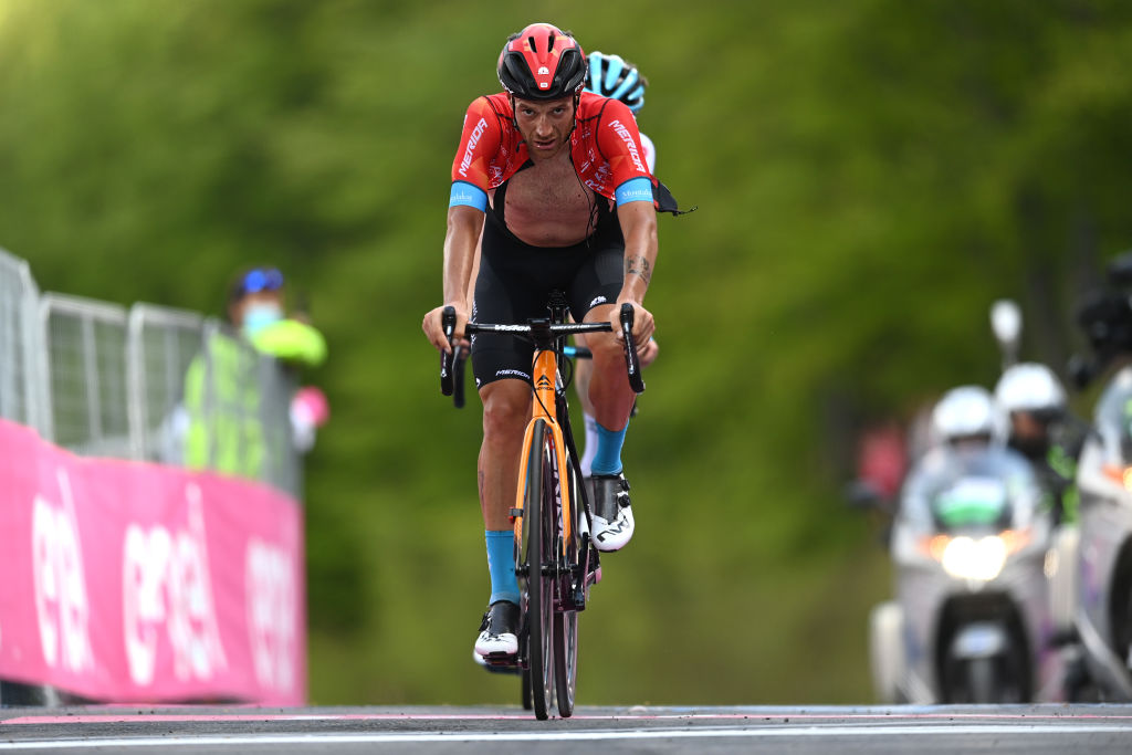 ALPE DI MERA VALSESIA ITALY MAY 28 Damiano Caruso of Italy and Team Bahrain Victorious at arrival during the 104th Giro dItalia 2021 Stage 19 a 166km stage from Abbiategrasso to Alpe di Mera Valsesia 1531m Stage modified due to the tragic events on May the 23rd 2021 that involved the Mottarone Cableway UCIworldtour girodiitalia Giro on May 28 2021 in Alpe di Mera Valsesia Italy Photo by Stuart FranklinGetty Images