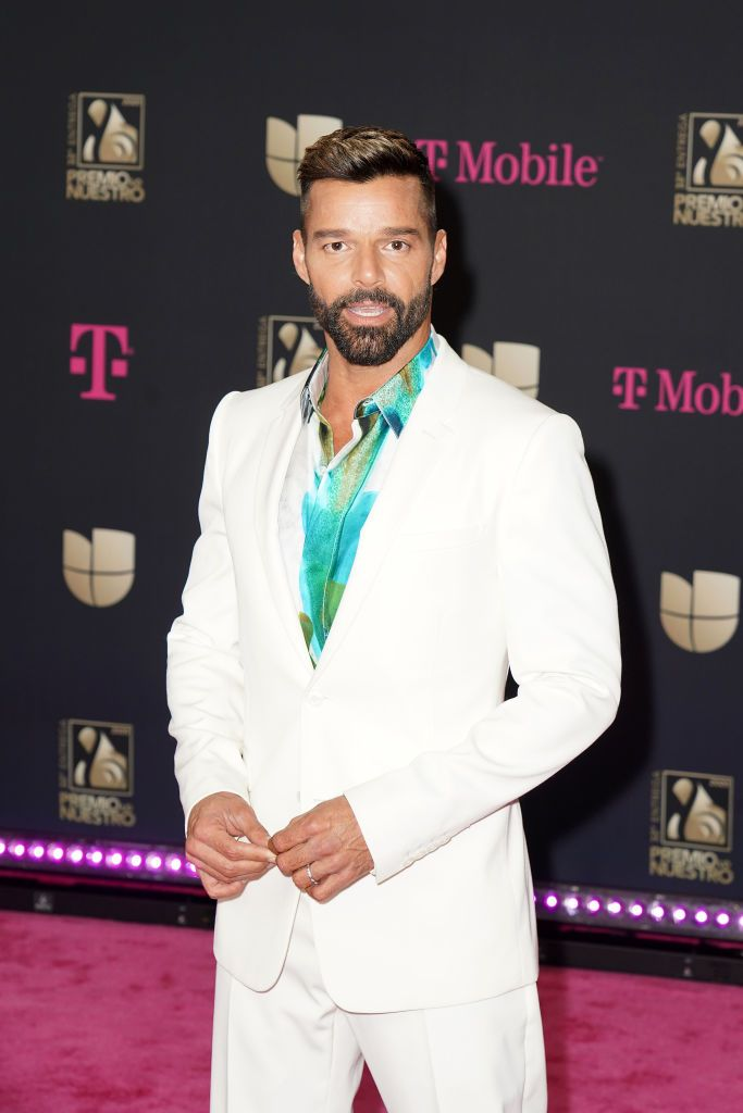 ricky martin in a white suit