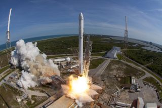 A SpaceX Falcon 9 rocket and Dragon spacecraft lift off from Space Launch Complex 40 at the Cape Canaveral Air Force Station in April 8, 2016 in Florida in this file photo. SpaceX will launch its next Dragon cargo mission for NASA from the pad on Dec. 11,