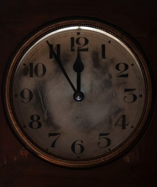 Doomsday clock at five until midnight
