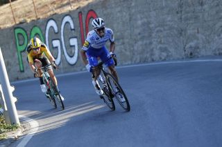 Team DeceuninckQuickStep rider Frances Julian Alaphilippe R rides next to Team JumboVismarider Belgiums Wout van Aert in the Poggio hill during the oneday classic cycling race MilanSan Remo on August 8 2020 Photo by Luca Bettini various sources AFP Photo by LUCA BETTINIPOOLAFP via Getty Images