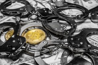 Bitcoin, cash and handcuffs stock image