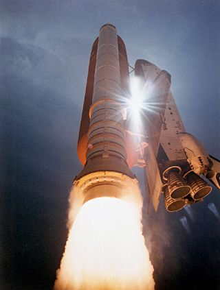 A space shuttle launches into space from NASA's Kennedy Space Center in Florida.