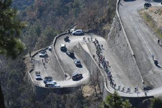 The riders climb the Col de la Madone