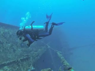 Vinisha Ranna, BDS, dives near wreckage in Sri Lanka. Ranna, a certified stress-and-rescue diver, is investigating the effect of scuba on the teeth.