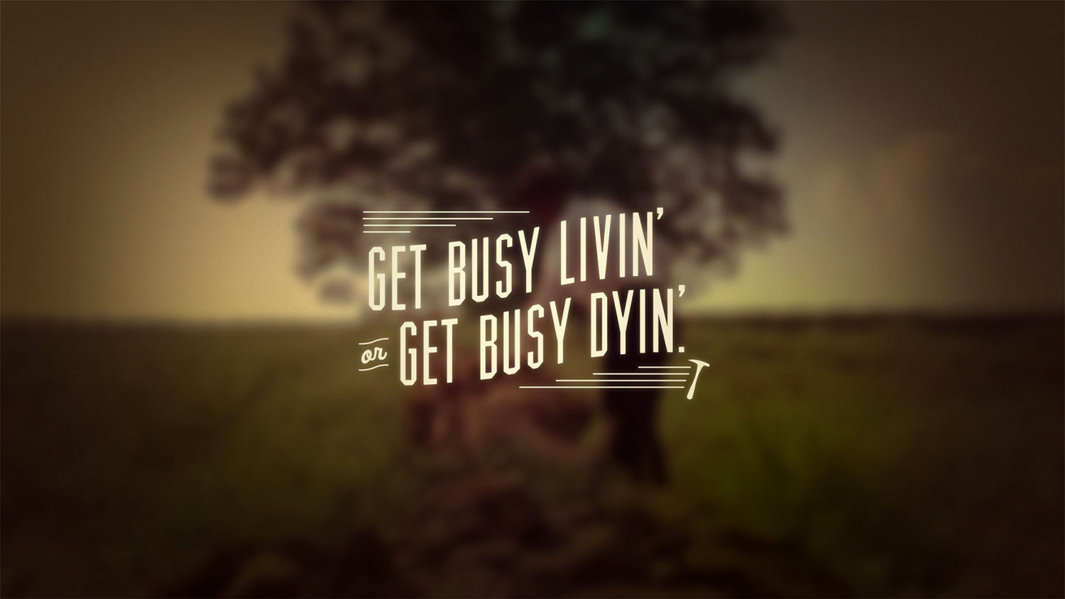 Blurred image of a tree with text overlaid saying 'Get busy livin' or get busy dyin''