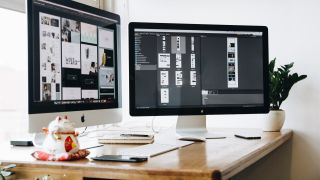 website being built on Mac, shown across two separate monitors at a desk
