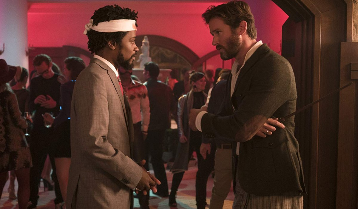 Sorry To Bother You Lakeith Stanfield and Armie Hammer talking at a party
