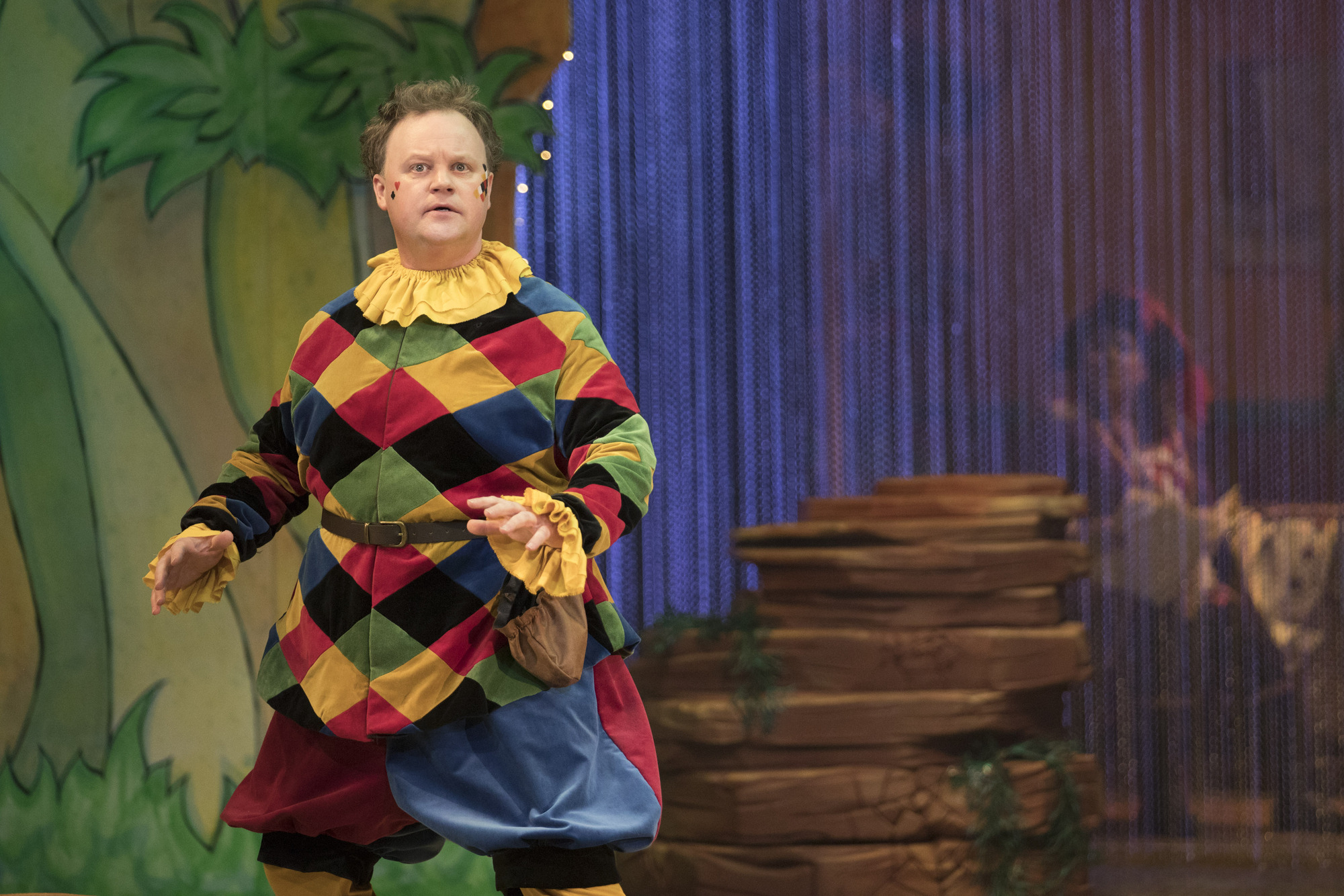 Justin Fletcher, aka Mr Tumble, in The Tempest and reading a story