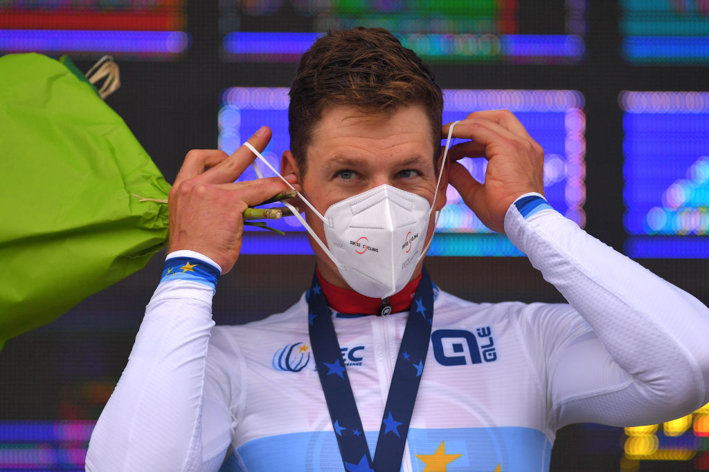 PLOUAY FRANCE AUGUST 24 Podium Stefan Kung of Switzerland Gold Medal European Champion Jersey Celebration Mask Covid Safety Measures during the 26th UEC Road European Championships 2020 Mens Elite Individual Time Trial a 256km race from Plouay to Plouay ITT UECcycling EuroRoad20 on August 24 2020 in Plouay France Photo by Luc ClaessenGetty Images