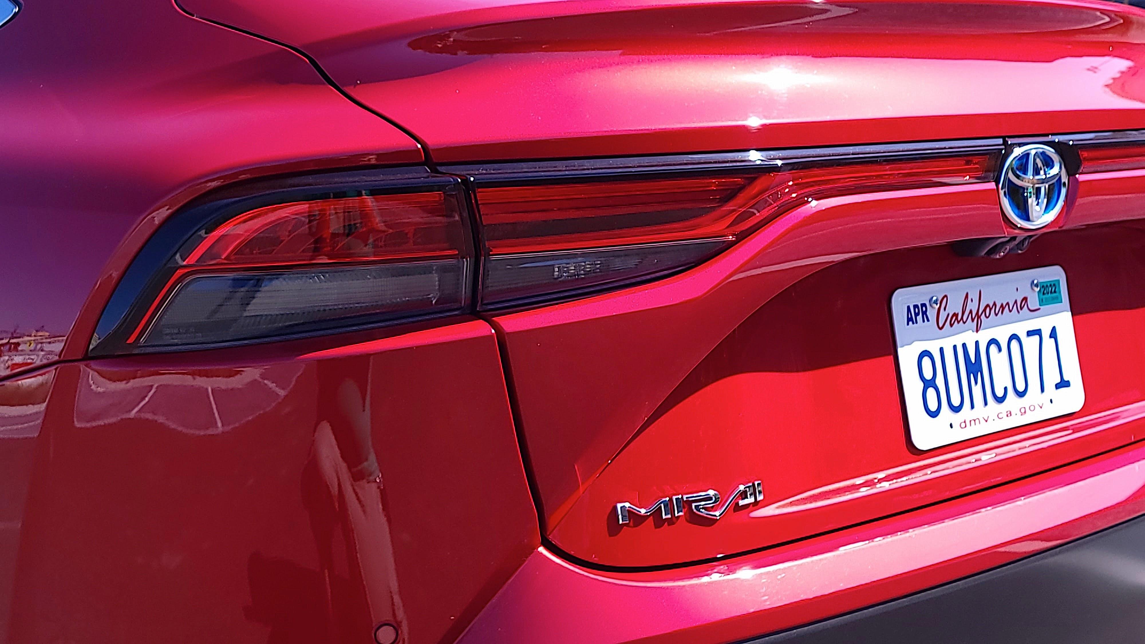 Close-up of Mirai badge on rear of car