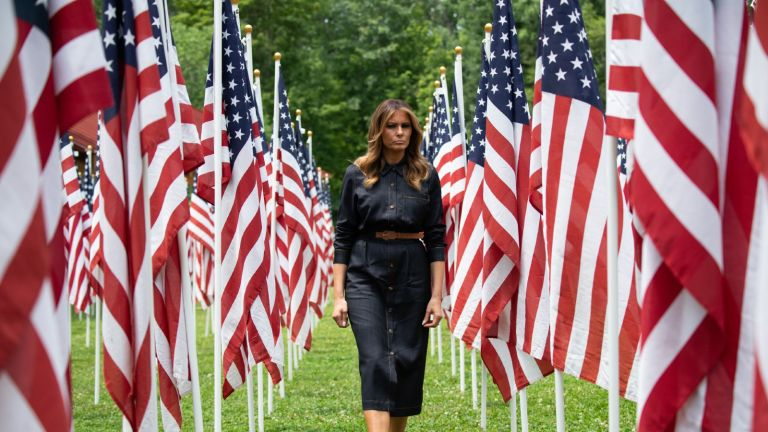 TOPSHOT - US First Lady Melania Trump walks through 453 American flags, each representing a child in foster care in Cabell County, West Virginia, many due to the opioid epidemic, at Ritter Park in Huntington, West Virginia, July 8, 2019. (Photo by SAUL LOEB / AFP) (