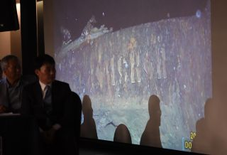 Choi Yong-seok, CEO of Shinil Group, looks at video footage taken by a submersible of the shipwreck (possibly the Dmitri Donskoi warship), during a press conference on a Russian ship in Seoul on July 26, 2018.