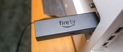 Amazon Fire TV Stick 4K Max plugged horizontally into TV