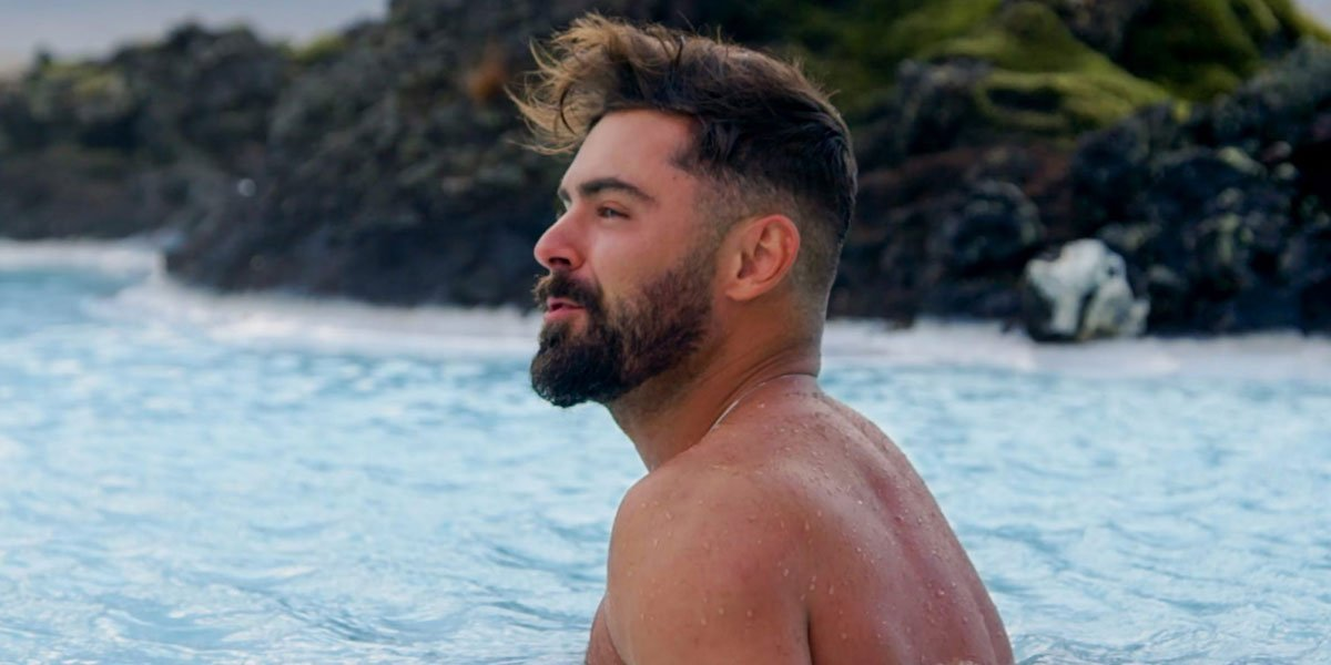 Zac Efron at the beach in Netflix's Down To Earth 2020