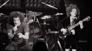 Brian Johnson (left) and guitarist Angus Young performing with heavy rock group AC/DC on tour in the UK, 1981