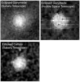 Ganymede and Callisto Eclipsed by Jupiter