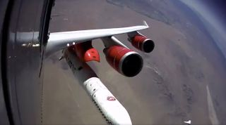 Virgin Orbit's LauncherOne rocket falls away from its carrier plane during the company's first-ever drop test on July 10, 2019.