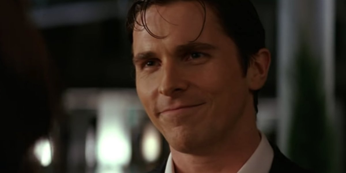 Christian Bale gives a smile as Bruce Wayne in Batman Begins