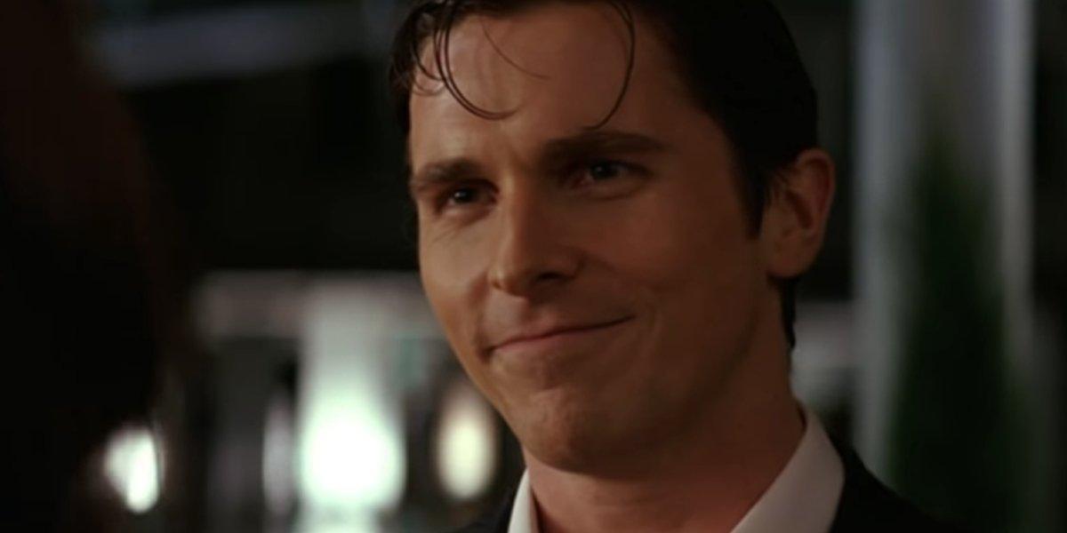 Christian Bale gives a smile as Bruce Wayne in Batman Begins