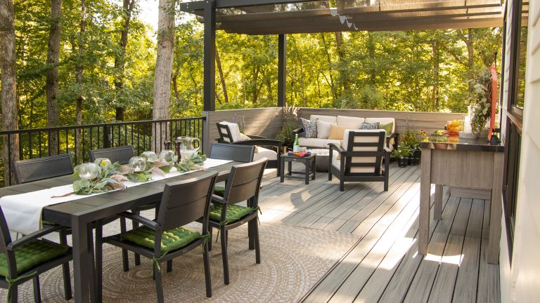 Low maintenance garden ideas with large decked area with dining and seating area
