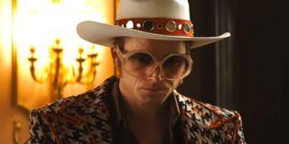 Rocketman Taron Egerton looking upset in full Elton John regalia