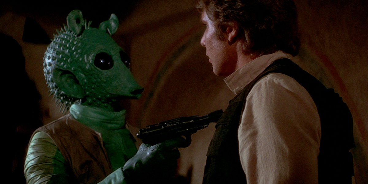 Greedo points blaster at Han Solo in Star Wars: A New Hope