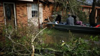 Residents are rescued from floodwater left behind by Hurricane Ida in LaPlace, Louisiana, U.S., on Monday, Aug. 30, 2021