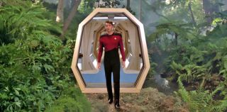 "Commander William Riker (Jonathan Frakes) enters the holodeck on the USS Enterprise in an episode of ""Star Trek: The Next Generation."""