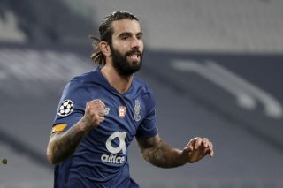 Sergio Oliveira scored twice to help Porto knock Juventus out of the Champions League.