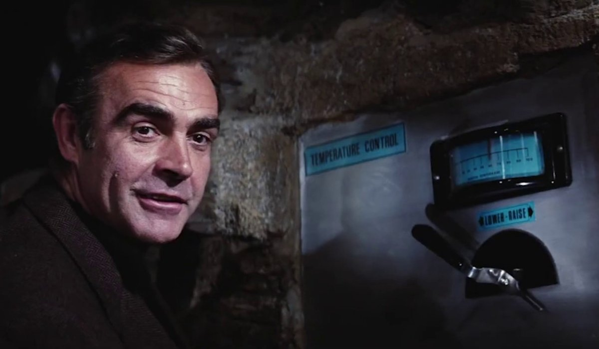 Diamonds Are Forever Sean Connery stands next to a very fatal switch