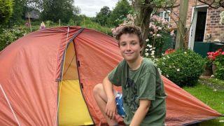 Boy camps in back garden