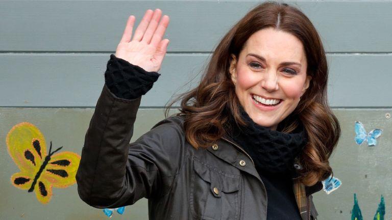 Kate Middleton wearing Barbour jacket waving