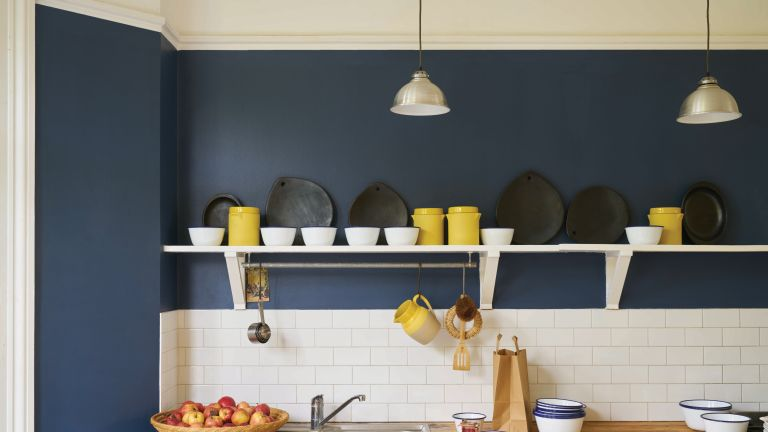 Dark blue wall in a kitchen with shelving and white tiles