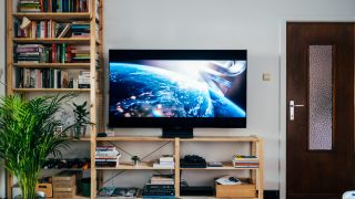 Flat screen TV on a wooden stand