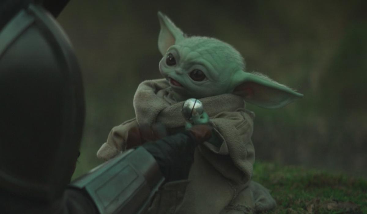 baby yoda grogu holding the razor crest knob